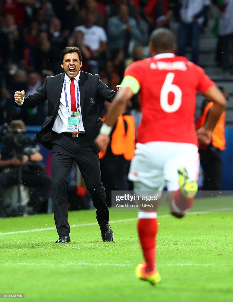 Chris Coleman (L) manager of Wales congratulates Ashley Williams (R) after scoring their first goal during the UEFA EURO 2016 quarter final match between Wales and Belgium at Stade Pierre-Mauroy on July 1, 2016 in Lille, France.