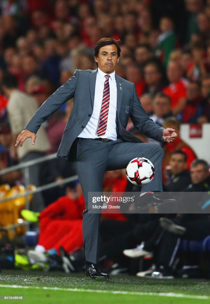 Chris Coleman manager of Wales controls the ball on the touchline during the FIFA 2018 World Cup Qualifier between Wales and Austria at Cardiff City Stadium on September 2, 2017 in Cardiff, Wales.