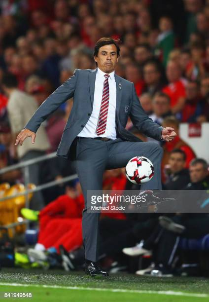 Chris Coleman manager of Wales controls the ball on the touchline during the FIFA 2018 World Cup Qualifier between Wales and Austria at Cardiff City...