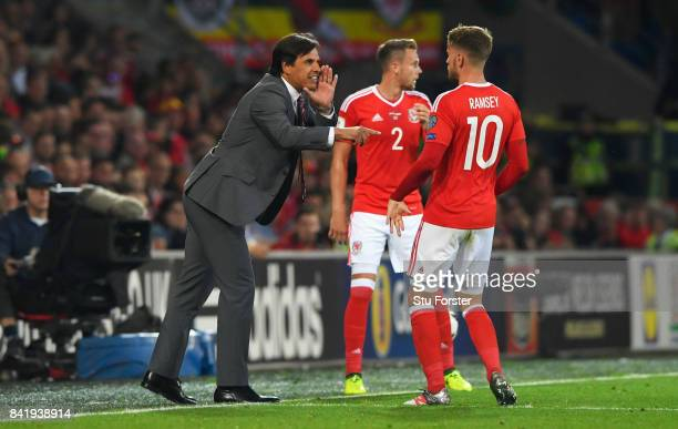 Chris Coleman manager of Wales gives instructions to Aaron Ramsey of Wales during the FIFA 2018 World Cup Qualifier between Wales and Austria at...
