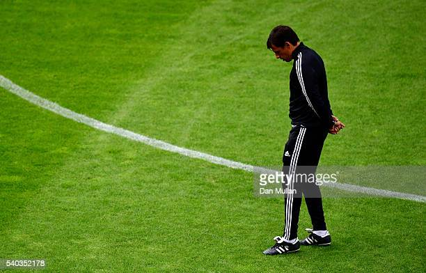 Chris Coleman Manager of Wales takes a look at the pitch during the Wales training session ahead of the UEFA Euro 2016 match against England at Stade...