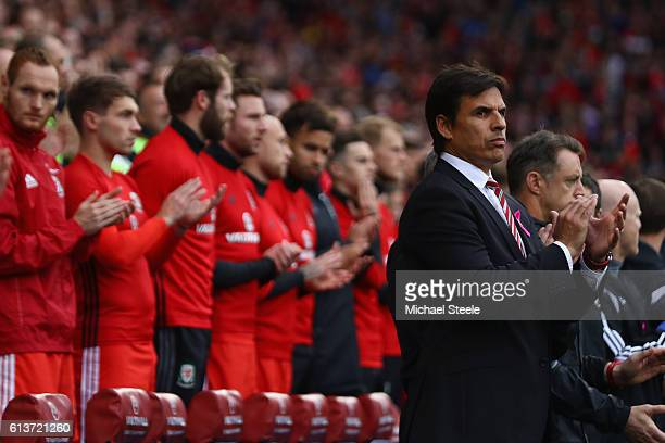Chris Coleman the coach of Wales during the national anthems ahead of the FIFA 2018 World Cup Qualifier between Wales and Georgia at Cardiff City...