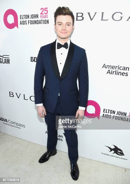 Chris Colfer attends the 26th annual Elton John AIDS Foundation Academy Awards Viewing Party sponsored by Bulgari celebrating EJAF and the 90th...