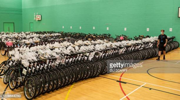 Chris Colgan, a member of Student Support Staff at the University of Bolton, inspects some of the 1000 bicycles the university has purchased which...