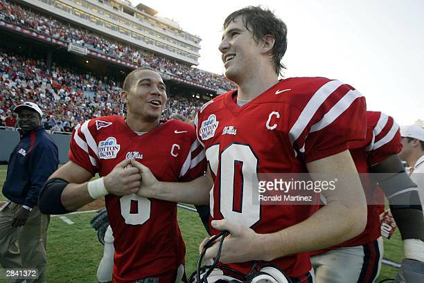 Chris Collins and Eli Manning of the Mississippi Rebels celebrate a 3128 victory against the Oklahoma State Cowboys during the SBC Cotton Bowl on...