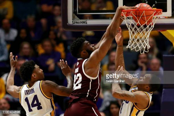 Chris Collins of the Texas AM Aggies dunks the ball over Ja'vonte Smart of the LSU Tigers during the first half at Pete Maravich Assembly Center on...