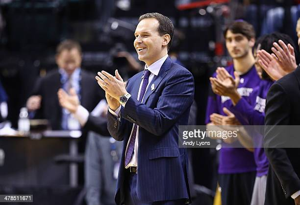 Chris Collins the head coach of the Northwestern Wildcats celebrates after the 6762 win over the Iowa Hawkeyes during the first round of the Big Ten...