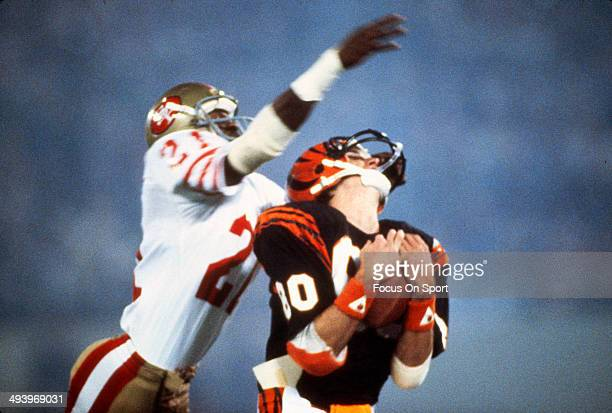 Chris Collinsworth of the Cincinnati Bengals catches a pass over Eric Wright of the San Francisco 49ers during Super Bowl XVI on January 24 1982 at...