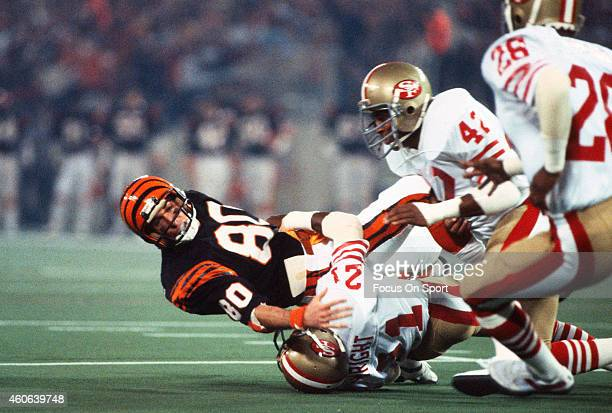 Chris Collinsworth of the Cincinnati Bengals gets tackled by Eric Wright of the San Francisco 49ers in Super Bowl XVI on January 24 1982 at the...
