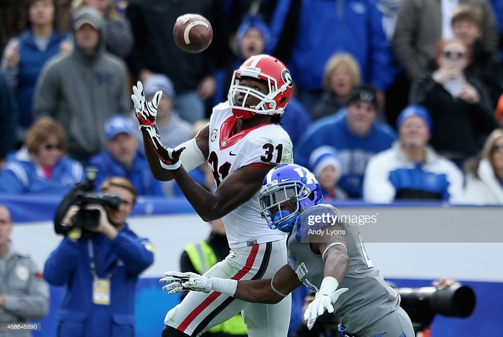 Chris Conley #31 of the Georgia Bulldogs catches a touchdown pass during the game against the Kentucky Wildcats at Commonwealth Stadium on November 8, 2014 in Lexington, Kentucky.