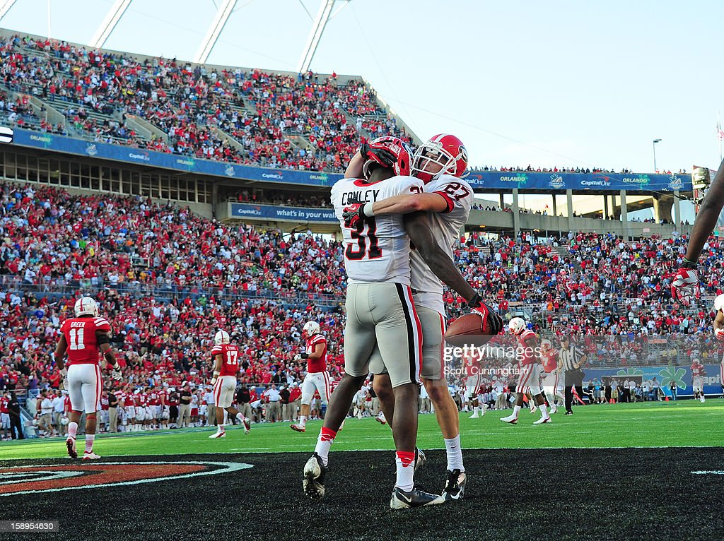 Chris Conley #31 of the Georgia Bulldogs is congratulated by Rhett McGowan #27 after scoring on an 87 yard reception against the Nebraska Cornhuskers during the Capital One Bowl at the Citrus Bowl on January 1, 2013 in Orlando, Florida.