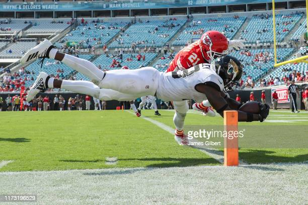Chris Conley of the Jacksonville Jaguars scores a touchdown in the second half against Bashaud Breeland of the Kansas City Chiefs at TIAA Bank Field...