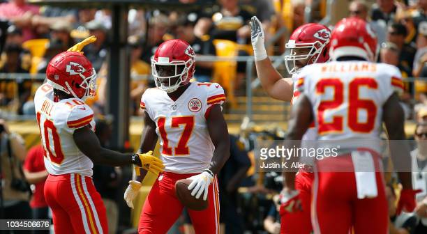 Chris Conley of the Kansas City Chiefs celebrates with Tyreek Hill after a 15 yard touchdown reception in the first quarter during the game against...