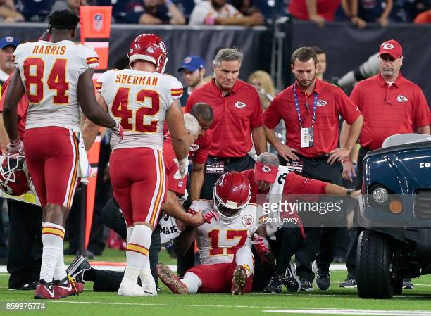 Chris Conley of the Kansas City Chiefs is tended to by medical staff as Anthony Sherman and Demetrius Harris look on at NRG Stadium on October 8 2017...