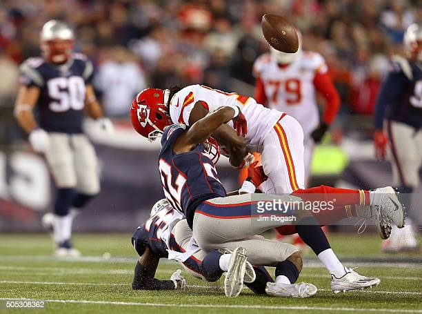 Chris Conley of the Kansas City Chiefs loses the ball against Devin McCourty and Justin Coleman of the New England Patriots in the second half during...
