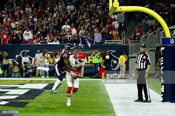 Chris Conley of the Kansas City Chiefs scores a touchdown against Kareem Jackson of the Houston Texans in the third quarter during the AFC Wild Card...