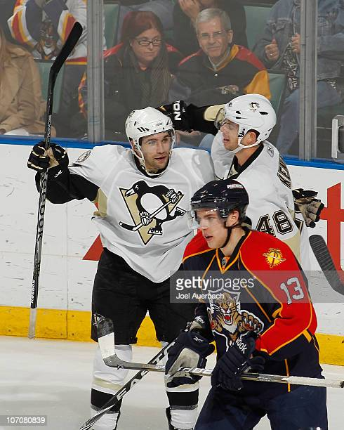 Chris Conner is congratulated by Tyler Kennedy of the Pittsburgh Penguins after he scored the winning goal in the third period against the Florida...
