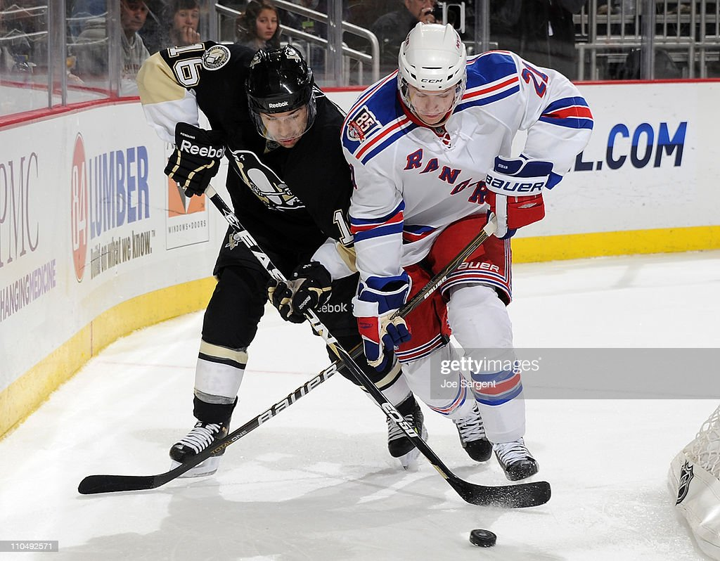 Chris Conner #16 of the Pittsburgh Penguins battles for the puck against Derek Stepan #21 of the New York Rangers on March 20, 2011 at Consol Energy Center in Pittsburgh, Pennsylvania. New York won the game 5-2.