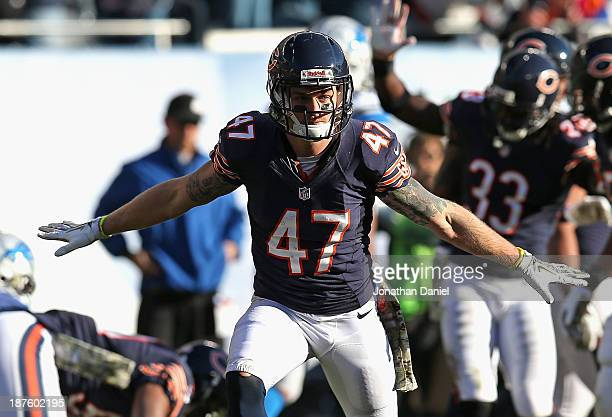 Chris Conte of the Chicago Bears celebrates an interception against the Detroit Lions at Soldier Field on November 10 2013 in Chicago Illinois The...
