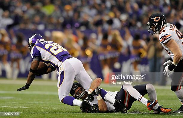 Chris Conte of the Chicago Bears tackles Adrian Peterson of the Minnesota Vikings during the first quarter of the game on December 9 2012 at Mall of...