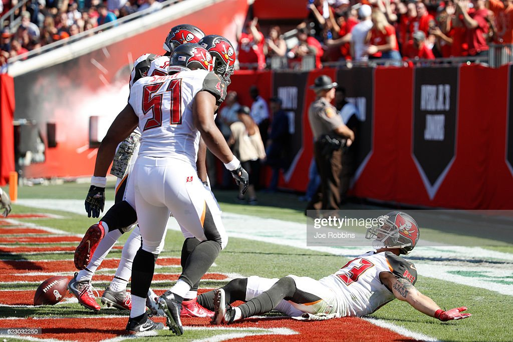 Chris Conte #23 of the Tampa Bay Buccaneers celebrates with teammates in the end zone after returning an interception 20 yards for a touchdown against the Chicago Bears in the first quarter of the game at Raymond James Stadium on November 13, 2016 in Tampa, Florida.