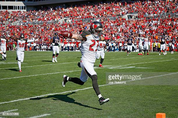 Chris Conte of the Tampa Bay Buccaneers returns an interception 20 yards for a touchdown against the Chicago Bears in the first quarter of the game...