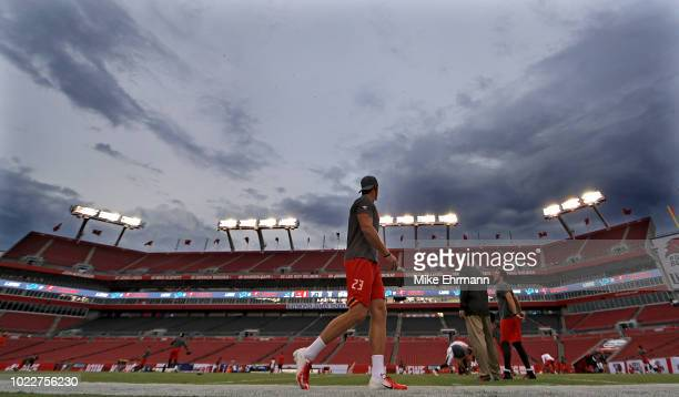 Chris Conte of the Tampa Bay Buccaneers warms up during a preseason game against the Detroit Lions at Raymond James Stadium on August 24 2018 in...