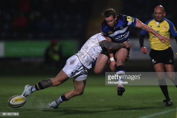 Chris Cook of Bath kicks on as Francois Hougaard of Worcester makes the tackle during the Aviva Premiership match between Worcester Warriors and Bath...