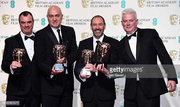 Chris Corbould Roger Guyett Paul Kavanagh and Neal Scanlan winners of the Visual Effects award for 'Star Wars The Force Awakens' pose in the winners...