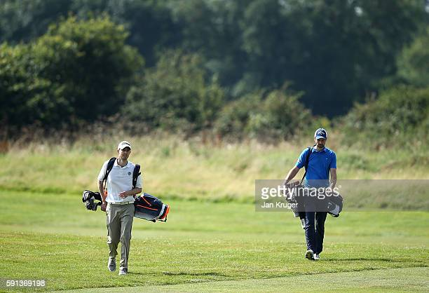 Chris Corry of Cuddington GC and partner Adam Hinton of Leatherhead GC make their way to the green during day one of the PGA Fourball Championship at...
