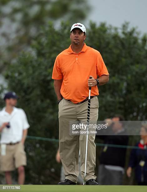 Chris Couch of Orlando reacts to the sound of the horn going off before he was able to putt out on the fourteenth hole during the fourth round of the...