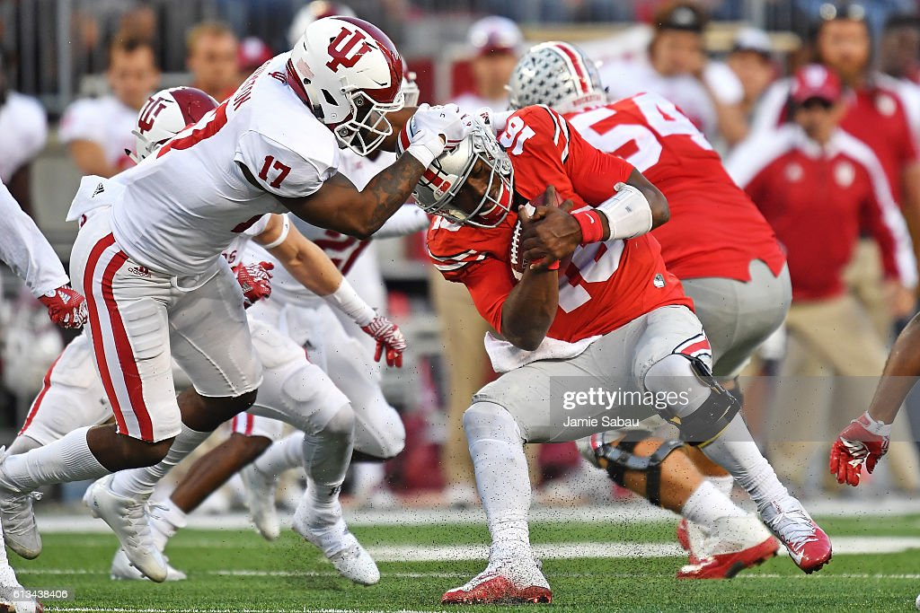 Chris Covington #17 of the Indiana Hoosiers wrestles down J.T. Barrett #16 of the Ohio State Buckeyes in the fourth quarter at Ohio Stadium on October 8, 2016 in Columbus, Ohio. Ohio State defeated Indiana 38-17.