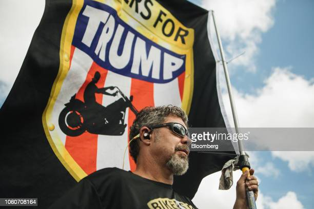 Chris Cox founder of Bikers for Trump holds a flag during a protest outside the Broward County Supervisor of Elections office in Lauderhill Florida...