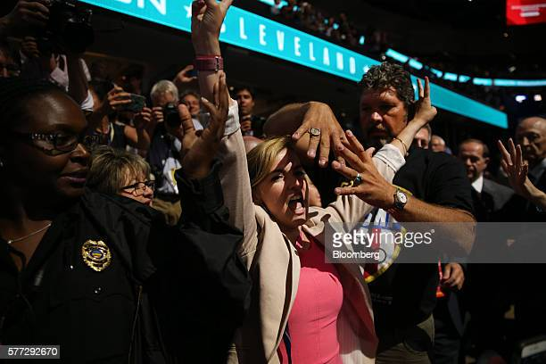Chris Cox head of Bikers for Trump right covers the face of a Code Pink protester center during the Republican National Convention in Cleveland Ohio...