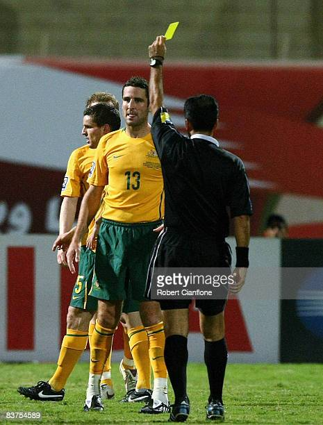 Chris Coyne of Australia is shown the yellow card by referee Masoud Moradi Hasanali during the Group A 2010 FIFA World Cup qualifier match between...
