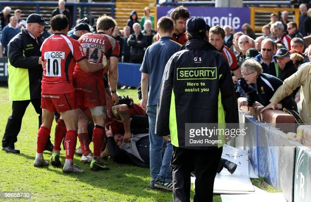 Chris Cracknell of Worcester pulls out father of team mate James Collins after a fracas in the crowd after the Guinness Premiership match between...