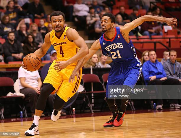 Chris Crawford of the Canton Charge drives against Melvin Johnson III of the Delaware 87ers during the 201415 Canton Charge Home Opener on November...