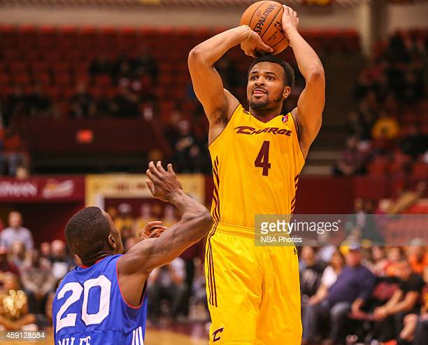 Chris Crawford of the Canton Charge shoots over LaQuentin Miles of the Delaware 87ers during the 201415 Canton Charge Home Opener on November 15 2014...