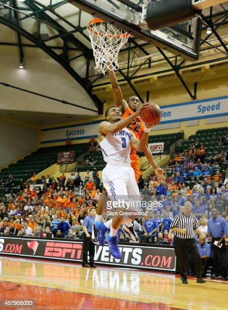 Chris Crawford of the Memphis Tigers attempts a shot against Markel Brown of the Oklahoma State Cowboys during the Old Spice Classic at HP Field...