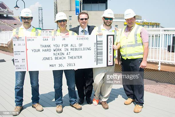 Chris Crestone and Skanska Project Workers attend the press preview of the newly restored Nikon At Jones Beach Theater after being damaged by...