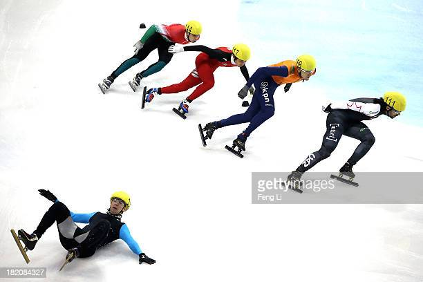 Chris Creveling of United States crashes out as Charles Hamelin of Canada, Jeroen Sonneveld of Netherlands, Chen Dequan of China and Csaba Burjan of...
