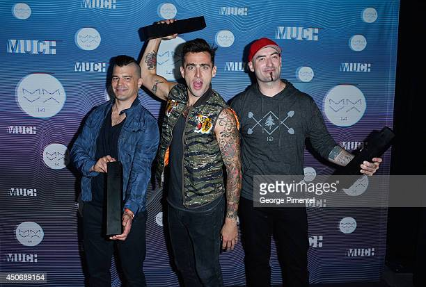 Chris Crippin Jacob Hoggard and Tommy Mac of Hedley pose in the press room at the 2014 MuchMusic Video Awards at MuchMusic HQ on June 15 2014 in...