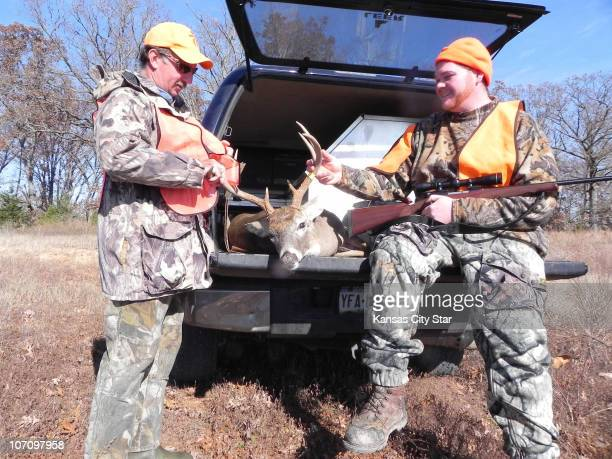 Chris Crull right celebrated taking a big buck near Lake of the Ozarks with Randy Moseley the outfitter on whose land he was hunting