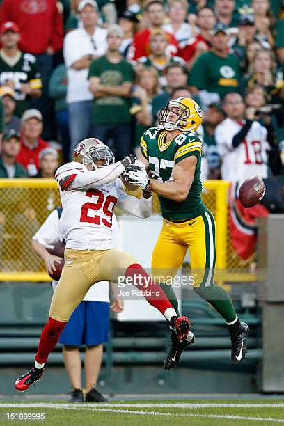 Chris Culliver of the San Francisco 49ers breaks up a fourth down pass intended for Jordy Nelson of the Green Bay Packers during the game at Lambeau...