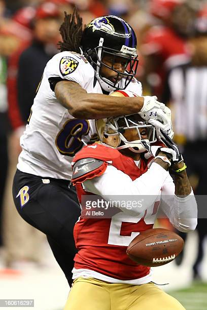 Chris Culliver of the San Francisco 49ers defends a pass to Torrey Smith of the Baltimore Ravens in the second quarter during Super Bowl XLVII at the...