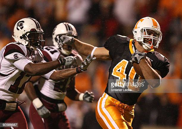 Chris Culliver of the South Carolina Gamecocks tries to stop Austin Johnson of the Tennessee Volunteers as he breaks away for a touchdown at Neyland...