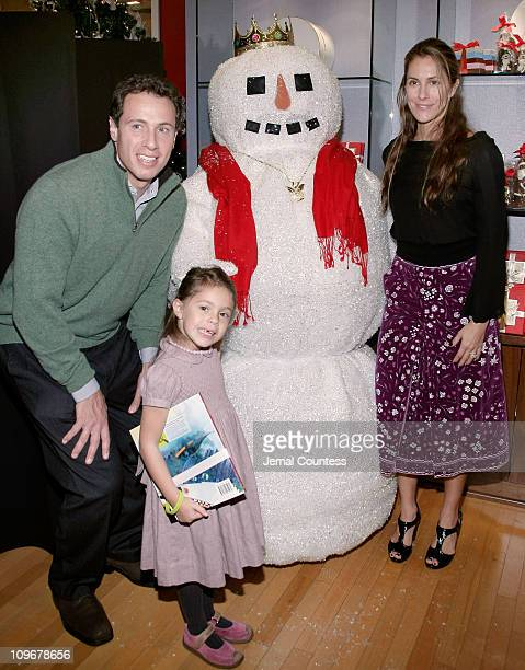Chris Cuomo Bella Cuomo and Cristina Cuomo pose with one of The Snow People at the PreParty for the Saks Fifth Avenue Holiday Window Unveiling at...