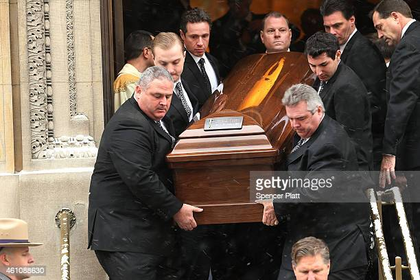 Chris Cuomo helps carry the casket of his father former threeterm governor Mario Cuomo as it departs St Ignatius Loyola Church on January 6 2015 in...