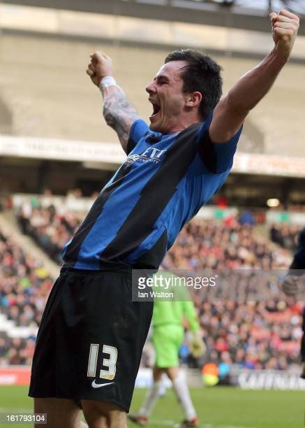 Chris Dagnall of Barnsley celebrates after scoring his team's third goal during the FA Cup Fifth Round match between MK Dons and Barnsley at...