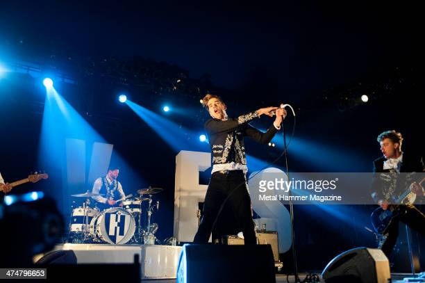Chris Dangerous Howlin' Pelle Almqvist and Nicholaus Arson of Swedish garage rock group The Hives performing live on the Pepsi Max Stage at Download...